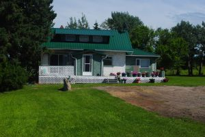 160 acres with home, shop and outbuildings
