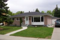 SOLD! 5211 Grove Hill Road SW - Calgary, Alberta